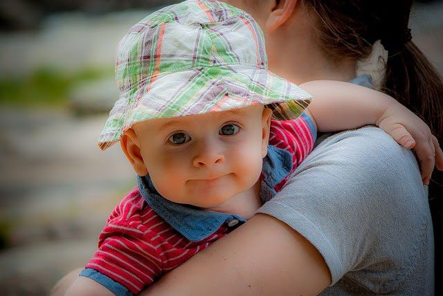 smiling baby with hat