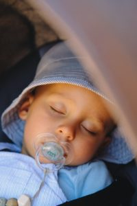 Baby sleeping with a pacifier